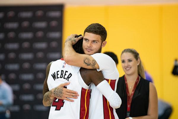 Tyler Johnson jokingly gives Briante Weber a hug