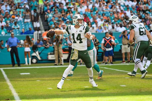 New York Jets quarterback Sam Darnold (14) throws on the run