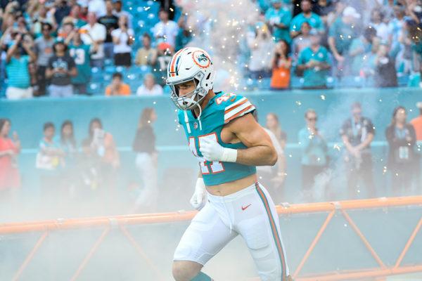 Miami Dolphins outside linebacker Kiko Alonso (47) runs out through the smoke