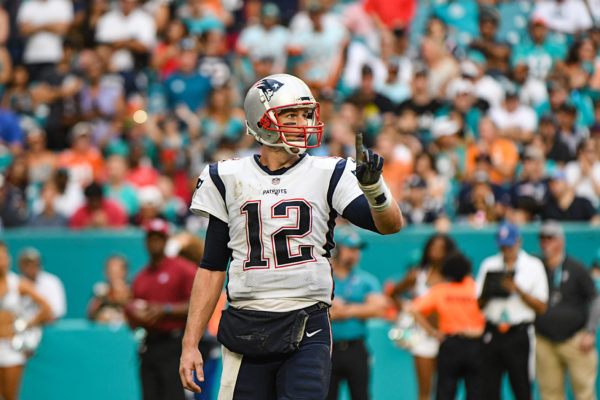 New England Patriots quarterback Tom Brady (12) signals 1 to the bench before a timeout