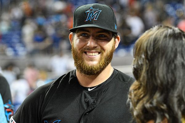 Miami Marlins left fielder Austin Dean (44) is all smiles after his 4 hit performance