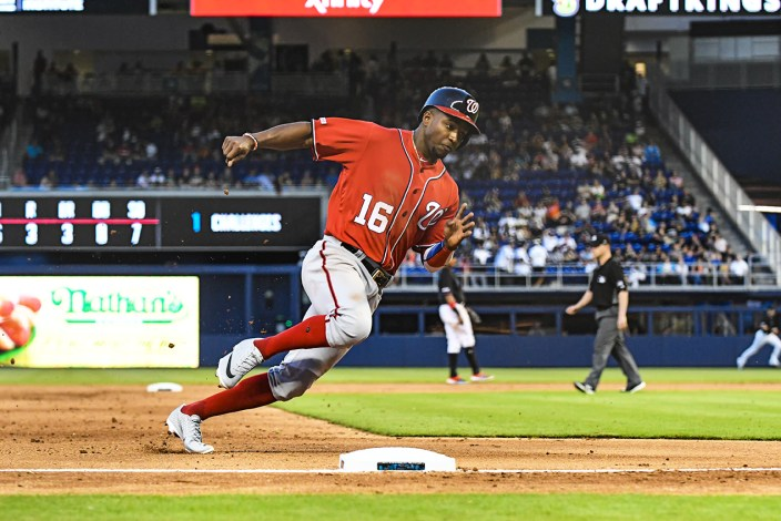 Washington Nationals center fielder Victor Robles #16 rounding 3rd base