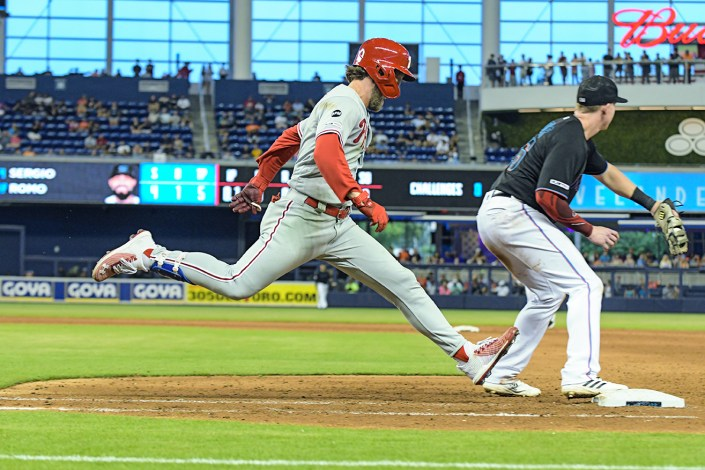 Philadelphia Phillies right fielder Bryce Harper #3 tries to beat the throw - Philadelphia Phillies vs. Miami Marlins at Marlins Park