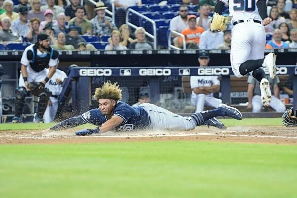 San Diego Padres Josh Naylor #22 slides across home - San Diego Padres vs. Miami Marlins at Marlins Park