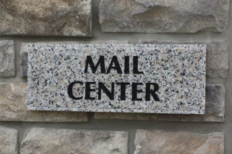Granite mail center sign