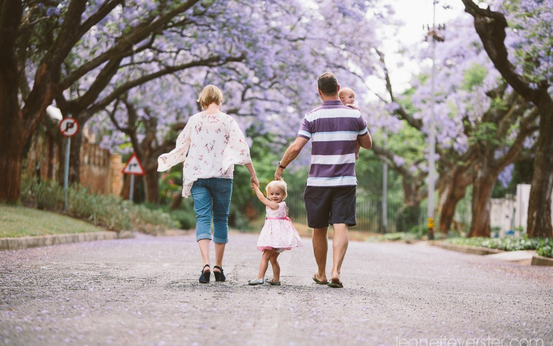 The Evans family with jacaranda streets and the Jozi skyline