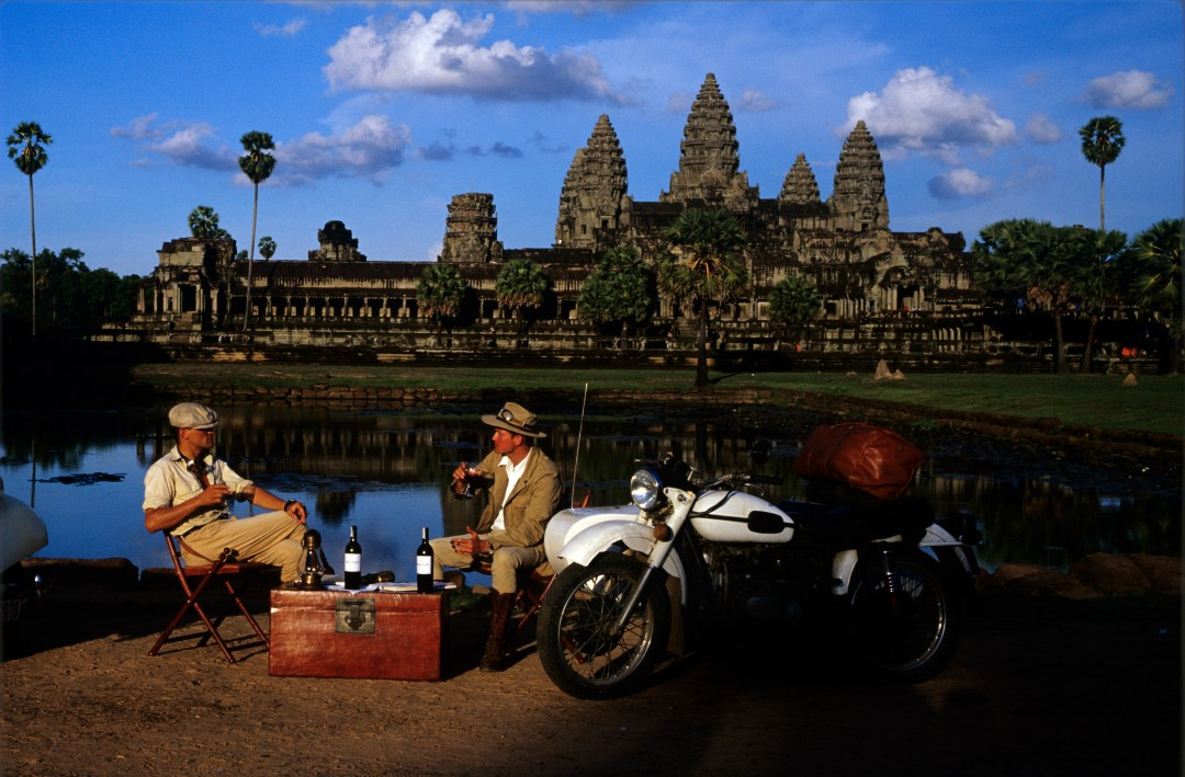 Jean Gaborit aviator boots used on recreation of 1908 motoring expedition through Indochina. Ankor Wat, Cambodia, in the background