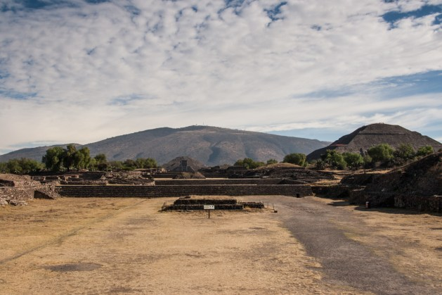 Looking down the Avenue of the Dead, from the edge of one of the sunken plazas. The Pyramid of the Sun is on the right, and the Pyramid of the Moon is straight ahead.
