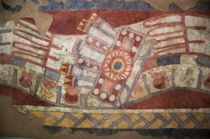 Symbols in this mural include shells and feathers on the body of the serpent, and the 'mat' in the border that may be an allusion to lineage.
