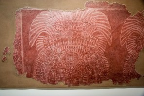 This is among the most graphically elaborate of the mural fragments we saw. The interlaced design on the central shield reminds me of patterns we saw on temples in Northern Thailand.