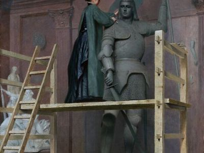 Painting, by the French artist Adolphe Demange, show the Duchesse d'Uzès working on a monumental sculpture of Jeanne d'Arc. The iron and bronze statue stood in the Place du Château at Mehun-sur-Yèvre. Mehun-sur-Yèvre is a small town in central France through which Jeanne d'Arc passed in late October of 1429, where she stayed with the king's surgeon, Renaud Thierry. There she participated in King Charles VII's council and on December 29, 1429 he provided her with letters of nobility. In the Spring of 1430 Jeanne left Mehun-sur-Yèvre to pursue other battles.