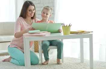 A woman with a child is reading