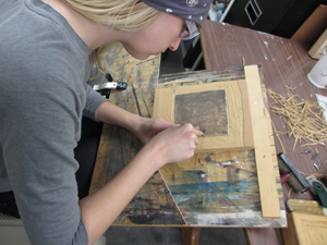 Jenni Higginbotham carving a relief block