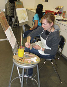 Student painting the figure