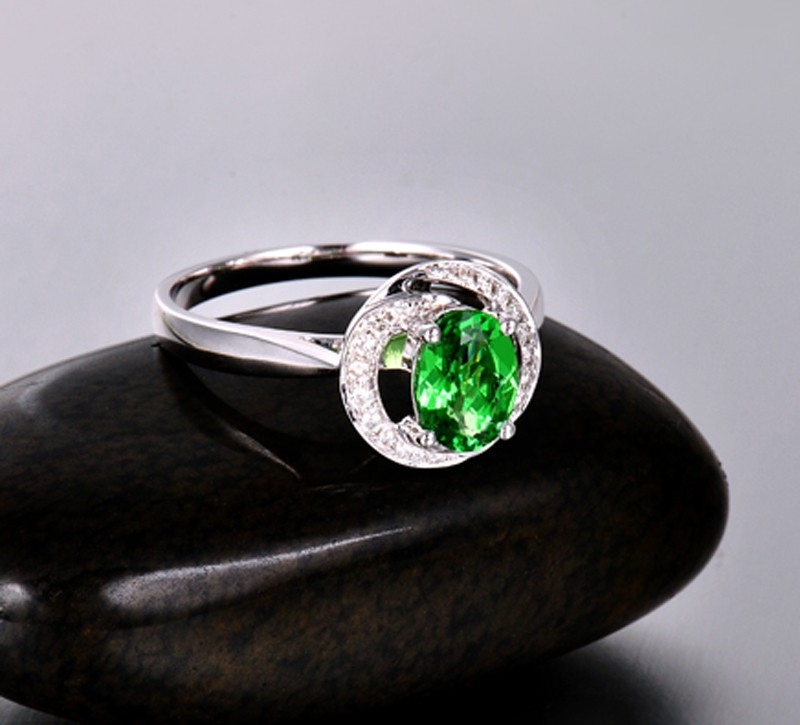 Unique 1 Carat Emerald and Diamond Halo Engagement Ring with floral design  JeenJewels