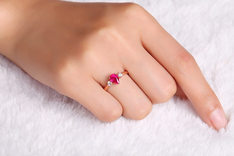 Trilogy Half Carat Pear Shape Ruby and Round Diamond Engagement Ring in Rose Gold  JeenJewels
