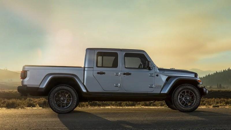 Display Grey overland gladiator parked at dusk