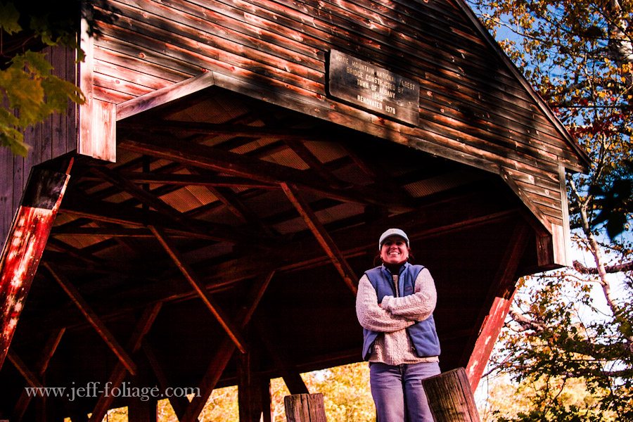 Woman standing for a picture while freezing in front of the Albany covered bridge
