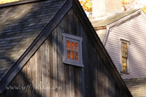 Fall color reflected in the window of the old manse