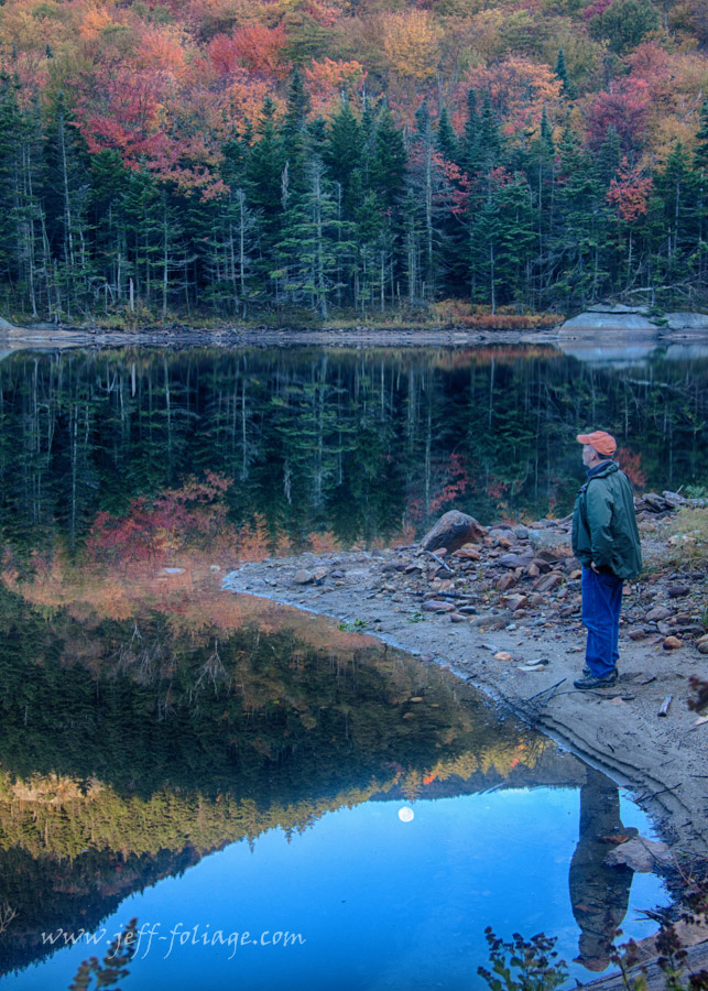 man views the fall colors at the Kinsman Notch Beaver Pond on Route 112