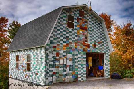 a vermont garage covered in license plates