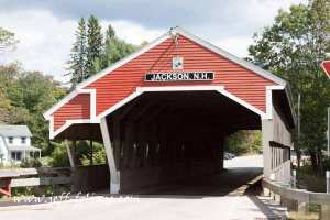 The Jackson NH covered bridge straddles the Ellis river