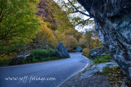 Hairpin turn in Vermonts Smuggler's Notch under New England fall foliage