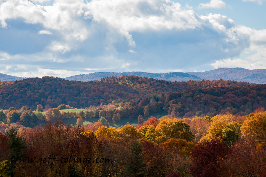 the rolling hills of Vermont and the fall color undulating as far as the eye can see.