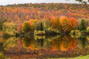 Fall foliage reflection on Coffin Pond in New Hampshire
