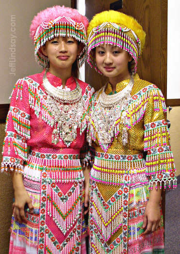 Two beautiful Hmong sisters from Menasha, Wisconsin in elaborate Hmong clothing shortly before performing a beautiful dance in Appleton at the Church of Jesus Christ of Latter-day Saints, Sept. 24, 2004.