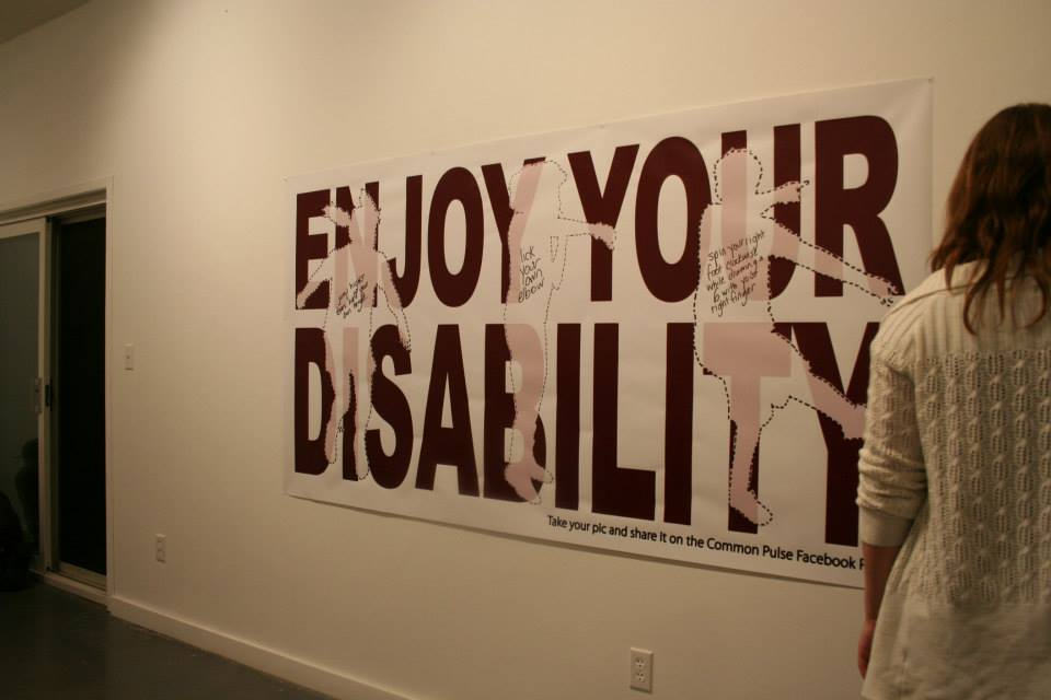 """Enjoy You Disability"" banner posted in the Durham Art Gallery"