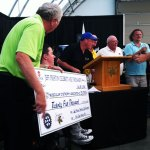 John Davidson and Jeff Preston preparing for the $25,000 cheque presentation