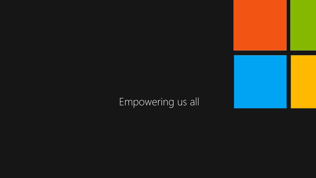 "Black background with centered white text stating ""Empowering us all"". Microsoft 'window' logo in the top right corner"