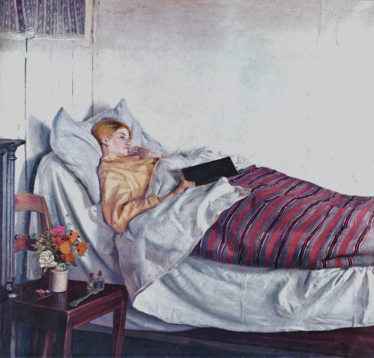 A young women laying in a bed, reading a book, with medicine vials on her bedside table