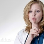 "Another female doctor holding her finger to her mouth saying ""shhh"""