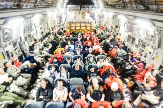 Abord the C17 flying Christchurch>McMurdo. People sit in conventional airplane seats, as well as on webbing seats along the walls. Additionally, my flight was carrying pallets of scientific equiptment and machinery.