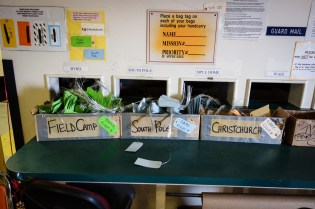 """Inside the shuttle facility at McMurdo Station. Everybody who is going to South Pole must tag their bags accordingly, so that bags are correctly routed when """"Bag Drag"""" happens - the loading of everybody's luggage into the luggage facility."""