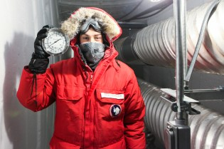 In the ice tunnels, me holding a thermometer reading -60F