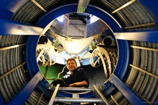 Physicist Colin Bischoff inside the Keck Array telescope mount.