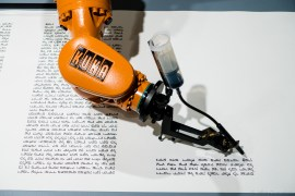 A robot writing a Torah at the Jewish Museum, Berlin