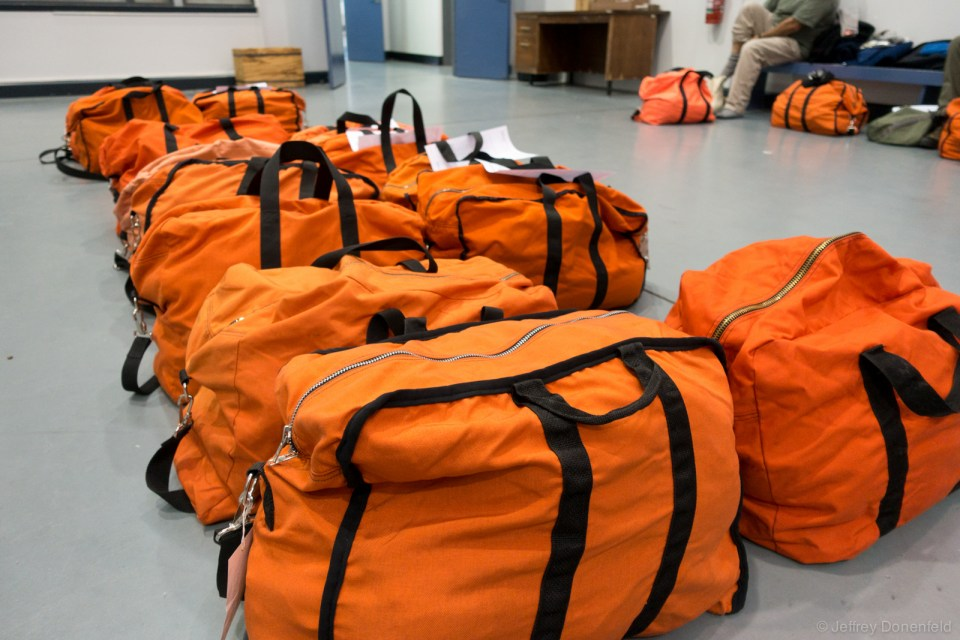 "These orange bags are called ""boomerang bags"", and are used for gear storage, checkin bags, as well as carry on bags. In Antarctica they're used for just about everything, since everybody is issued at least two."