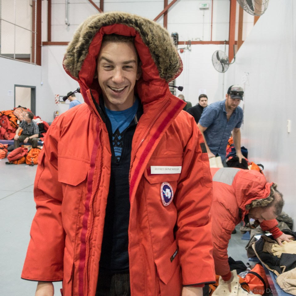 "Me trying on my Canada Goose brand ""Big Red"" standard issue parka. Each parka has an official program patch, as well as a nametag."