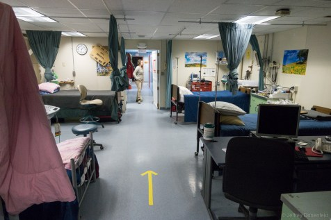 McMurdo has 6 full hospital beds for extended stays, in addition to four trauma bays. The yellow arrows on the floor point the direction of flow for triage and patient processing during a mass casualty incident where there are more patients than the hospital can normally handle.