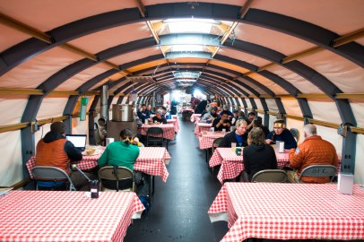 """From front to back of the galley tent. You can see two """"Preway"""" diesel fueled stoves on the left, with large water pots on the top. The stoves heat the tent, and some of the heat goes to keeping water hot, for hot water bottles, etc."""