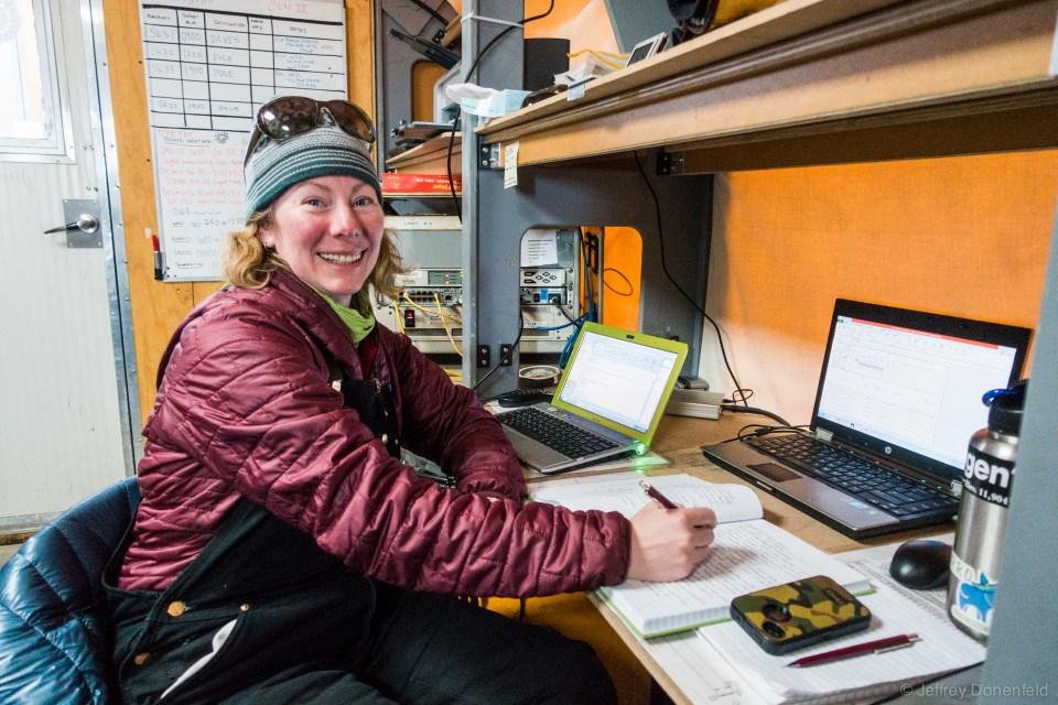 Weather observer Heather at her desk, logging observations.