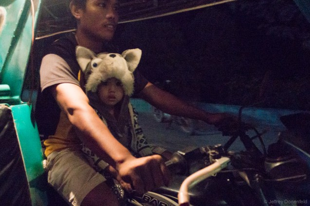 The cutest little girl ever, riding with her father as he biked us around El Nido.