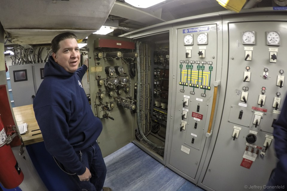 On the other side of the engine control room, the backup engine control system is the original Westinghouse system. Here, we're opening the original cabinet to inspect the original engine control, rheostats, etc.