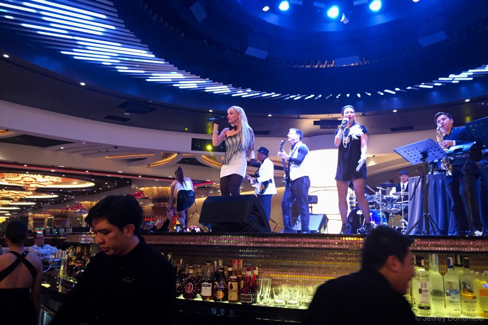 At the newly-opened City of Dreams Manila, I played a few rounds of Baccara, and then checked out an amazing cover band playing in the middle of the casino. Cover bands are hugely poplular in the Philippines, and they're very talented and precise.