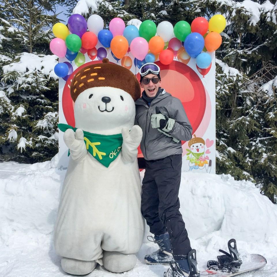 With the mascot Okamin!