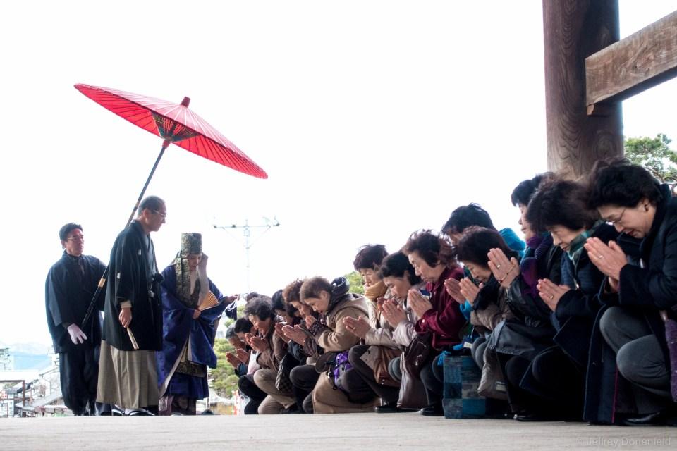 A nun blesses followers at the Zenkoji Temple, Nagano, Japan